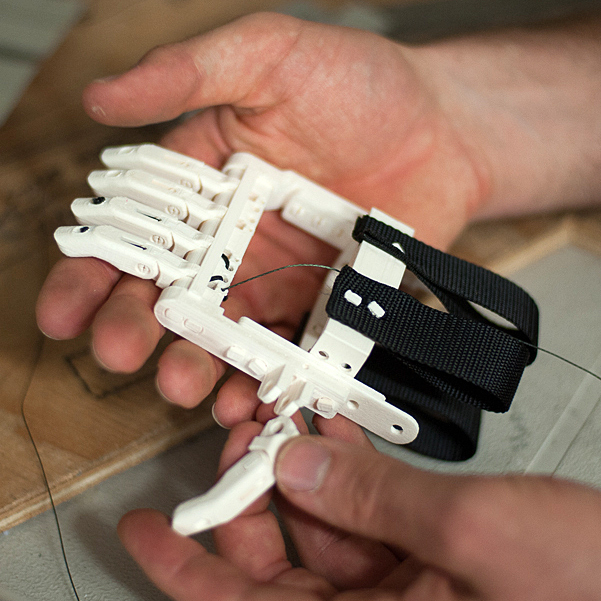 The newest version of the Robohand is made of snap-together parts, reducing the amount of hardware needed.