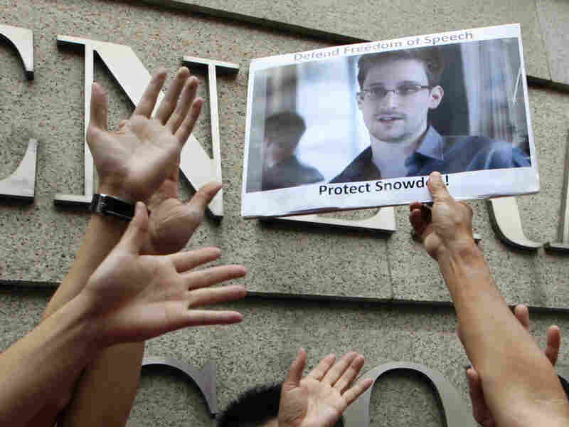 A supporter holds a picture of Edward Snowden, a former CIA employee who leaked top-secret information about U.S. surveillance programs, outside the U.S. Consulate General in Hong Kong on June 13.