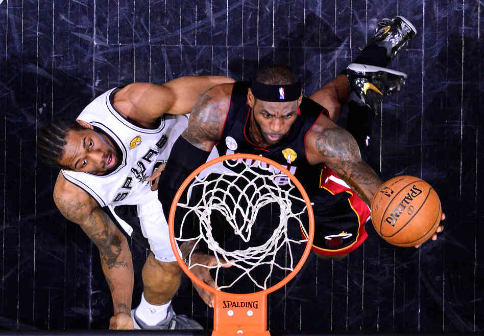 LeBron James of the Miami Heat goes up for a shot against Kawhi Leonard of the San Antonio Spurs during Game 4 of the NBA Finals at the AT&T Center in Sa