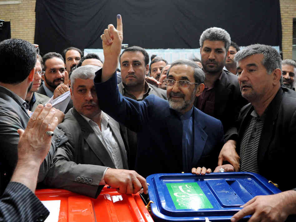Ali Akbar Velayati, a conservative presidential candidate, shows his ink-stained finger as he votes at a polling station on Friday.