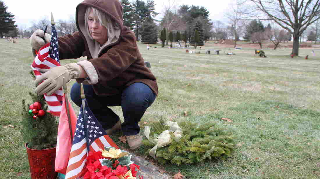 Anna Rodriguez tends the grave of her son, Nick. She learned shortly after Nick's death that, because his death was a suicide, his name would not be included on a local memorial to fallen soldiers. She has since found a memorial garden in York, Pa., that will add Nick's name to its memorial wall this summer.