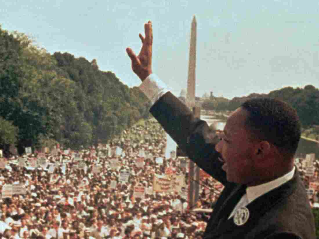 "Martin Luther King Jr. waves at the crowd on the National Mall following his ""I Have a Dream"" speech."