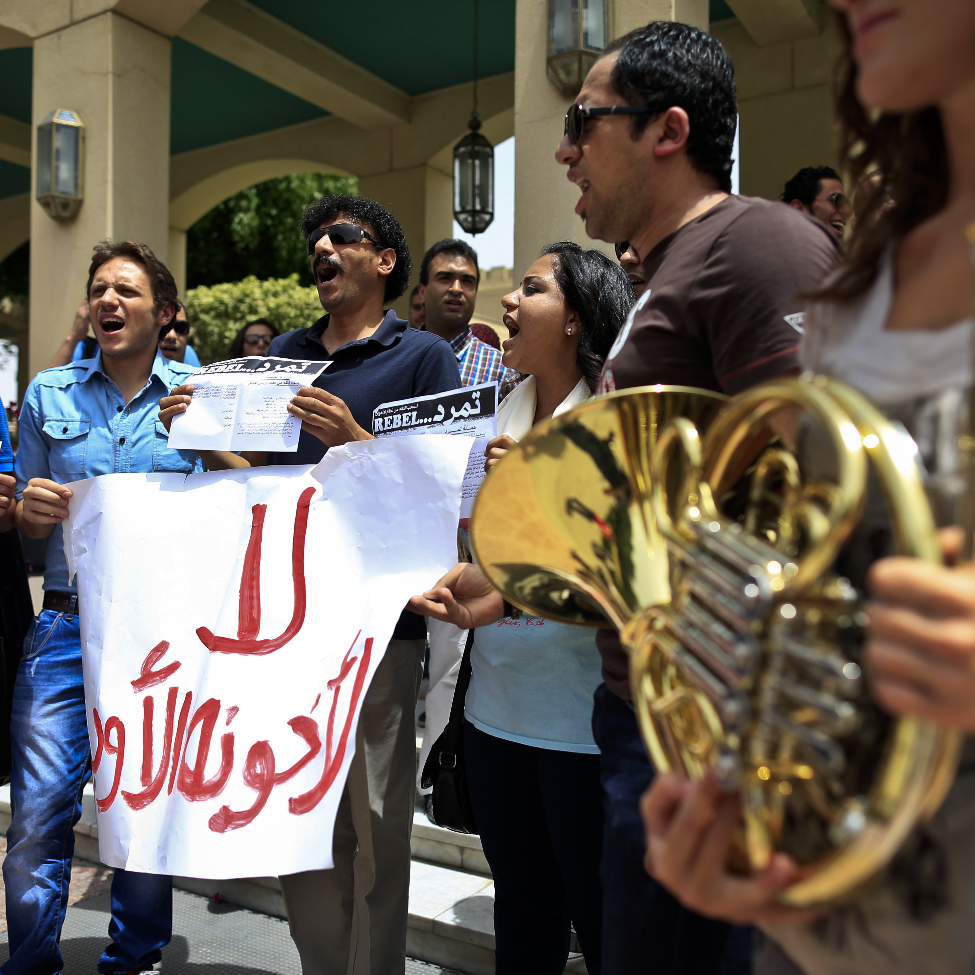 Egyptian employees and students chant slogans during a protest in support of Enas Abdel-Dayem, head of the Cairo Opera House, on May 29. The Cairo Opera House has become a new battleground between supporters and opponents of Egypt's Islamist president, clashing over the direction of the Middle East's oldest music institution.