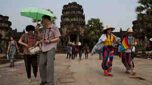Tourists visit Angkor Wat in Siem Reap province, Cambodia, in April.