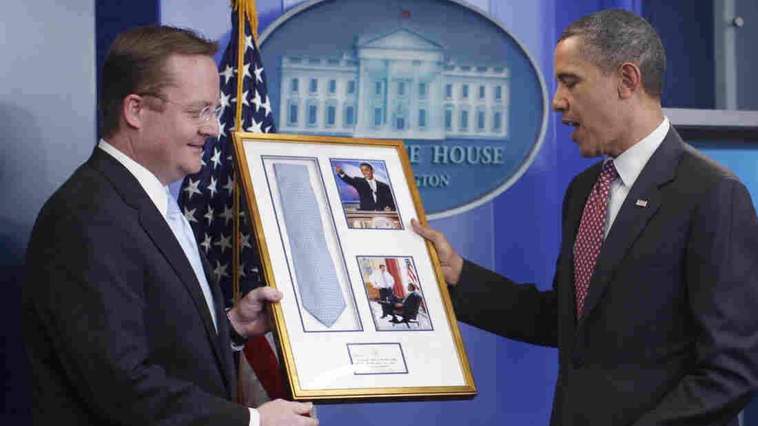 President Obama presents outgoing press secretary Robert Gibbs with a framed necktie in the White House briefing room on Feb. 11, 2011. Obama had borrowed the tie from Gibbs to wear for his keynote speech at the 2004 Democratic National Convention.