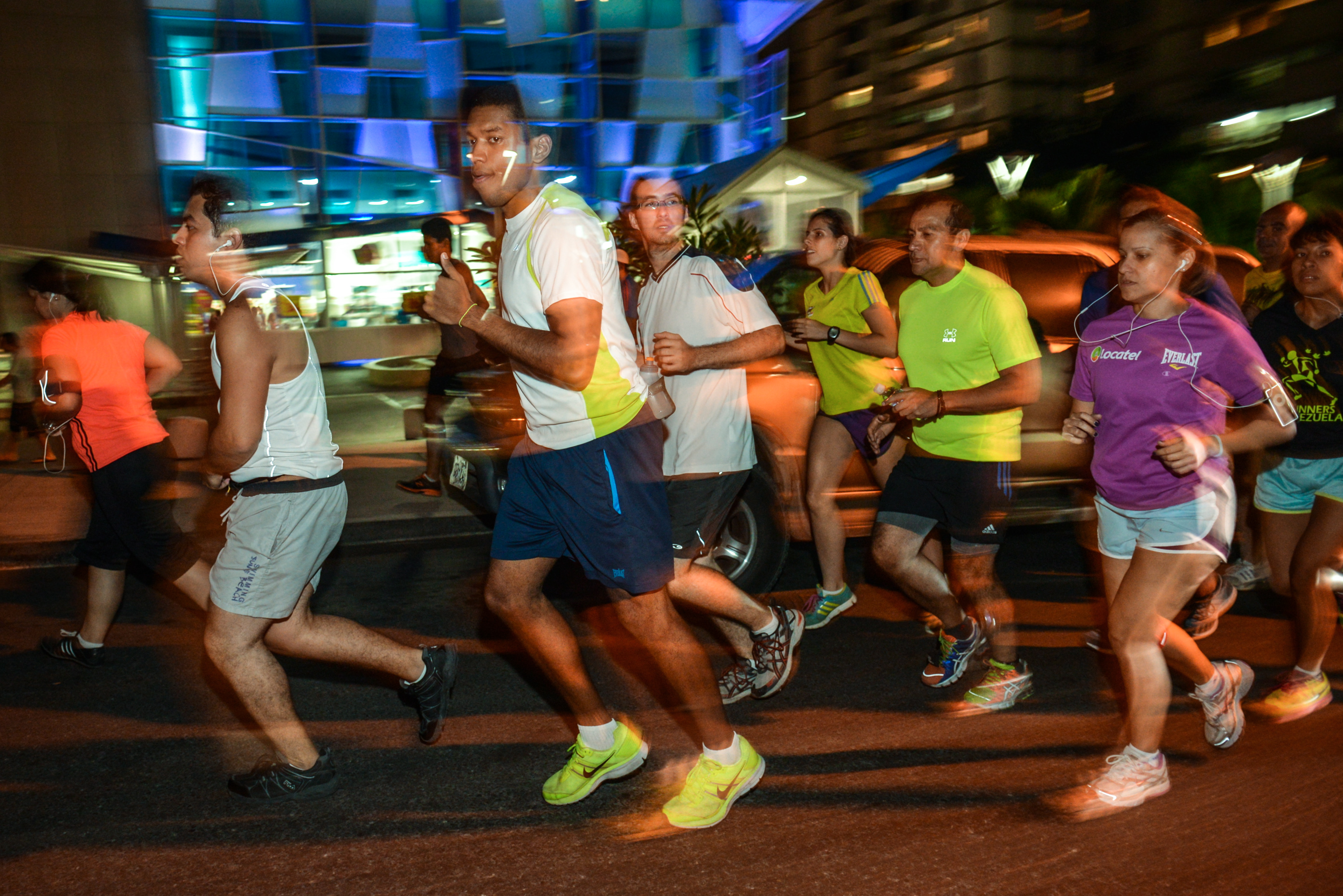 Some 300 people participate in group night runs in Caracas.
