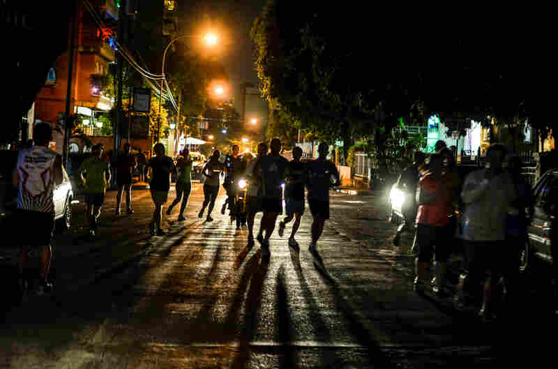 Most Venezuelans retreat indoors after dark, but members of Runners Venezuela have banded together to take back their streets.