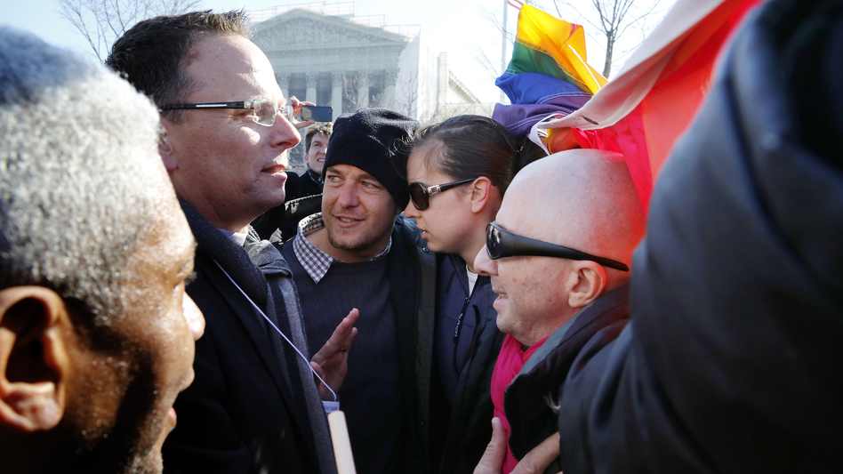 Anti-gay marriage protesters (left) try to persuade same-sex marriage supporters to get out of the way of their march in front of the Supreme Court. (Reuters/Landov)