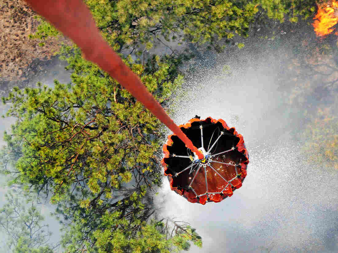 A U.S. Army helicopter releases water onto the Black Forest fire outside Colorado Springs, Colo.,  earlier this week.