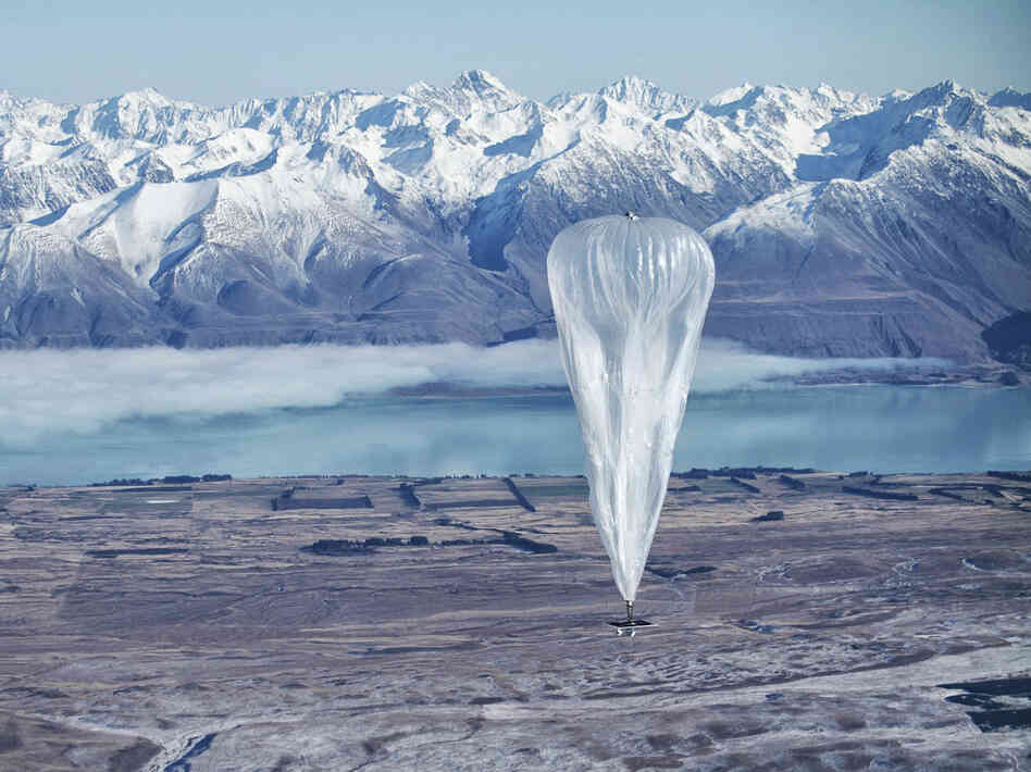 A Google balloon sails through the air with the Southern Alps in the background, in Tekapo, New Zealand, on Monday.
