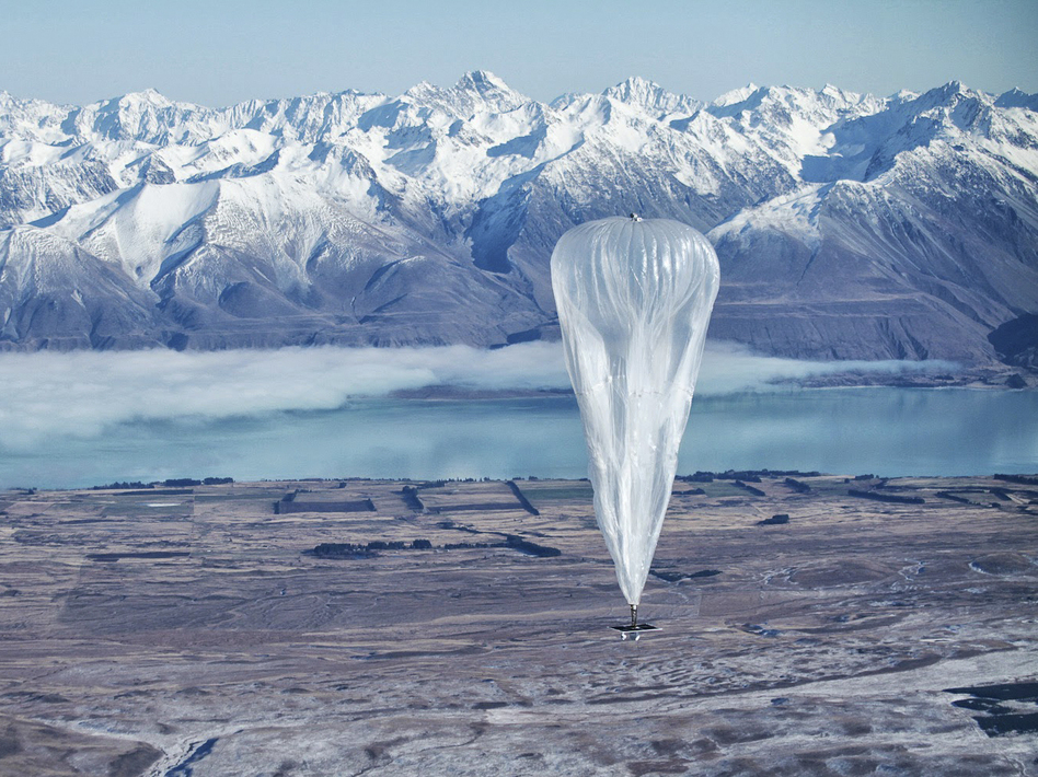 A Google balloon sails through the air with the Southern Alps in the background, in Tekapo, New Zealand, on Monday. (Jon Shenk/AP)
