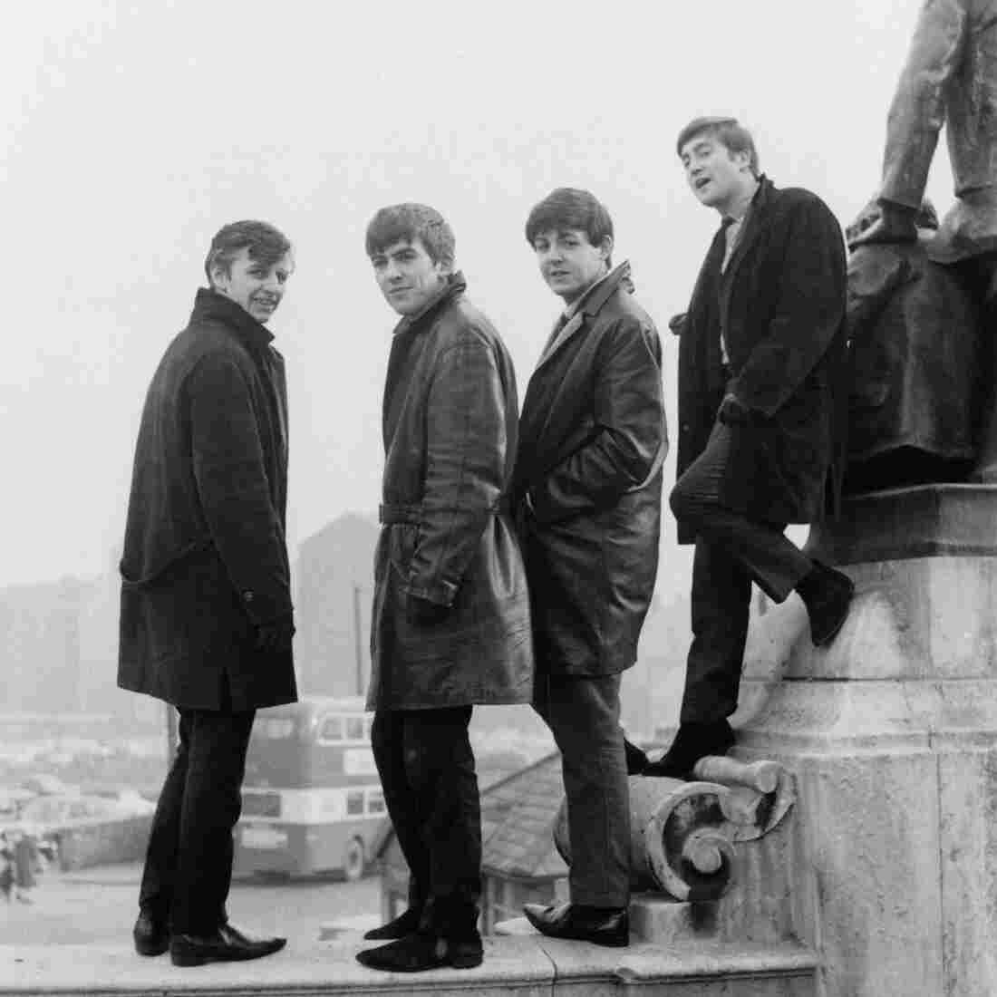 The Beatles pose in Liverpool's Derby Square in February 1963 — the year, according to author Colin Fleming, that yielded the band's most definitive work.