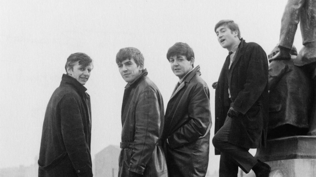 The Beatles pose in Liverpool's Derby Square in February 1963 — the year, according to author Colin Fleming, that yielded the band's most definitive work. (Getty Images)