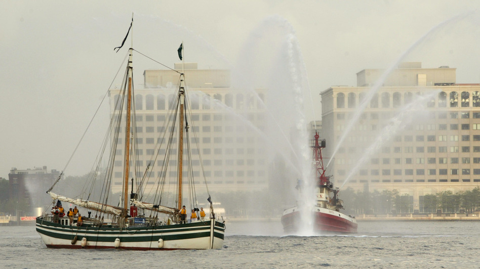 The Lois McClure (left) passes a fire boat as it arrives at New York's North Cove Marina in 2005. Canal schooners used wind power on open lakes, and lowered their masts and raised their centerboards to be towed through canals. (AP)