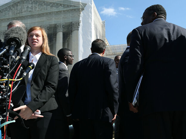 Abigail Noel Fisher, who challenged a racial component to University of Texas at Austin's admissions policy, speaks to the media outside the U.S. Supreme Court building during oral in the case in October.