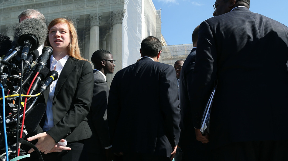 Abigail Noel Fisher, who challenged a racial component to University of Texas at Austin's admissions policy, speaks to the media outside the U.S. Supreme Court building during oral in the case in October. (Getty Images)