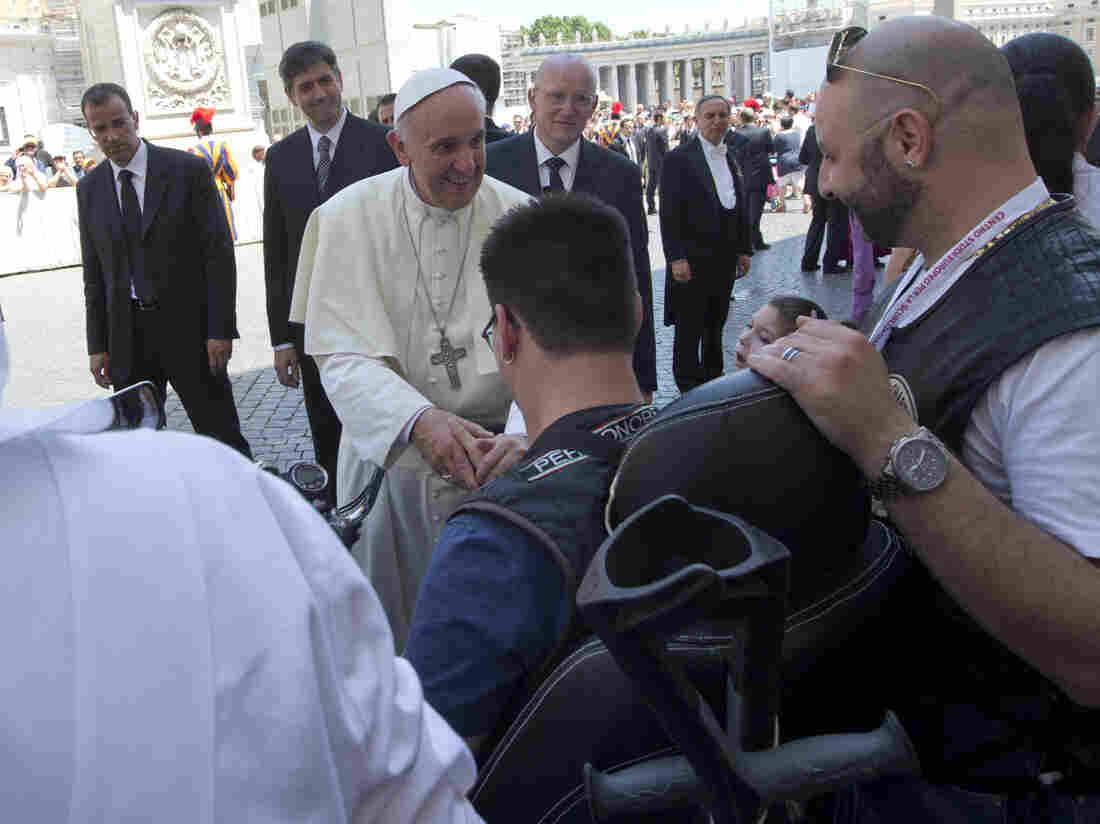 Pope Francis blesses a sick or disabled person wearing Harley-Davidson garb in St. Peter's Square, at the Vatican on Sunday.
