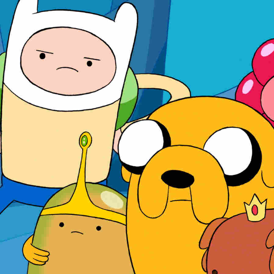 Finn is in the middle, with the skinny arms. Jake is the dog. Together, they have Adventure Time.