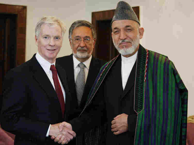 Then-U.S. ambassador to Afghanistan Ryan Crocker (left) shakes hands with Afghan President Hamid Karzai in 2011. During his 37 years as a diplomat, Crocker served as ambassador to six Muslim countries.