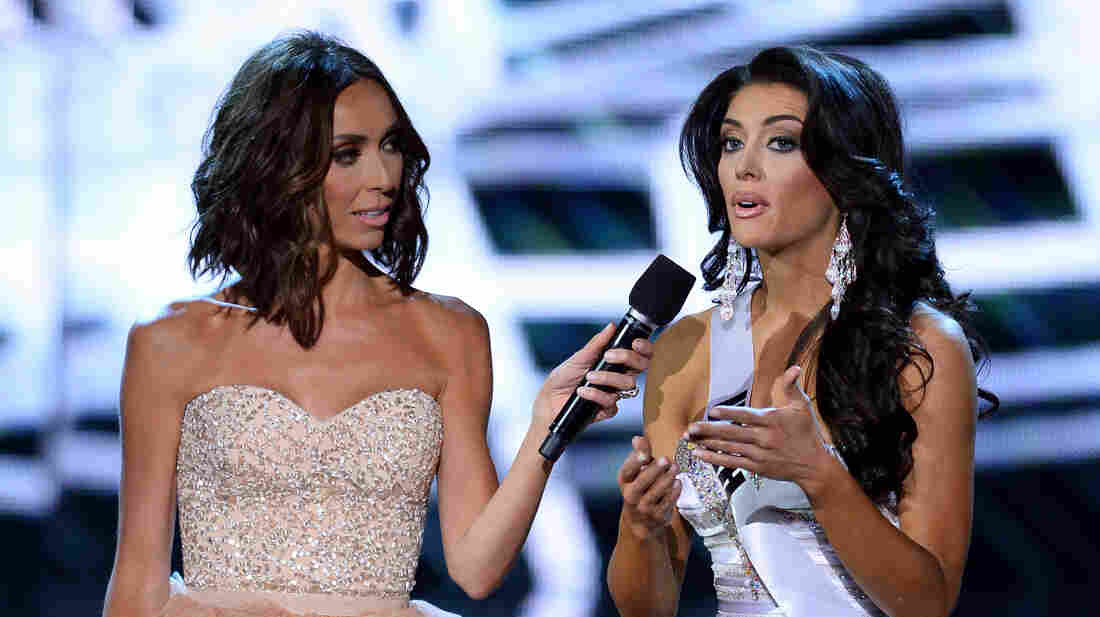 Television personality and host Giuliana Rancic looks on as Miss Utah USA Marissa Powell answers a question from a judge during the interview portion of the 2013 Miss USA pageant on Sunday night.
