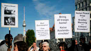 Protesters demonstrate in Berlin on Tuesday on the eve of President Obama's visit to the German capital. Obama is expected to encounter a more skeptical Germany in talks on trade and secret surveillance practices.