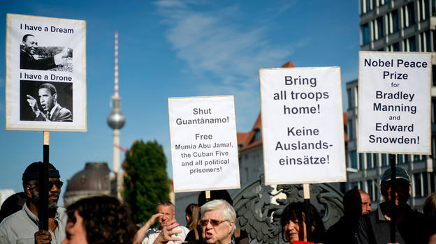 Protesters demonstrate in Berlin on Tuesday on the eve of President Obama's visit to the German capital. Obama is expected to encounter a more skeptical Germany in talks on trade and secret surveillance practices. (AFP/Getty Images)