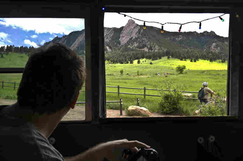 Banjo Billy guides the bus through Chautauqua Park, home to Boulder's signature Flatirons rock formation. The park is also home to mischievous tales of rock climbers gone wild.