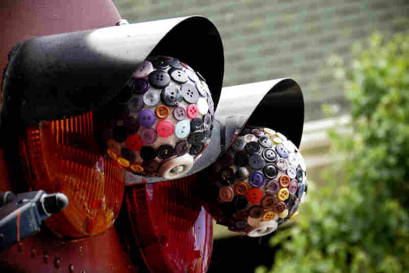 Button-craft disco balls dangle on the bus, capturing the whimsical spirit of the tour and its guide.