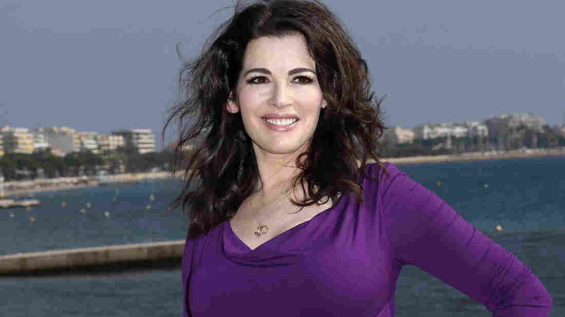 Nigella Lawson's husband has been cautioned by police after photos emerged of him with his hands around her neck. Lawson, a cookbook author and TV food personality, has not commented publicly.