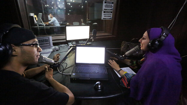 Libyan presenters work at the studio of Radio Zone in Tripoli, Libya, in 2012. The radio station's owners hope to teach a new generation about democracy.