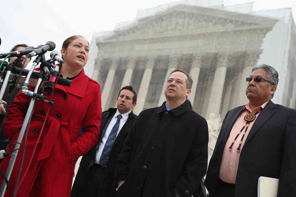 Mexican American Legal Defense and Education Fund Director of Litigation Nina Perales (from left), MALDEF lawyer Luis Figueroa, Georgetown University law professor Jon Greenbaum and San Carlos Apache Tribal Chairman Terry Rambler talk with reporters outside the U.S. Supreme Court after attending oral arguments in Arizona v. Inter Tribal Council et al. in March.