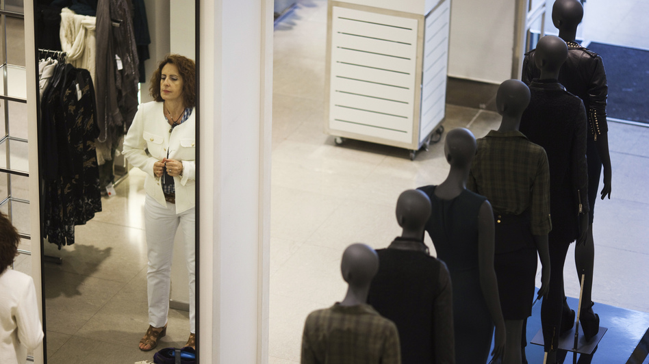 A woman tries on a jacket at a Zara store in Madrid. Zara's parent company, Inditex, was among Spanish companies to sign fire and building safety agreements for their factories in Bangladesh following a deadly factory collapse in April, though Inditex was not directly involved in that incident. (Susana Vera/Reuters/Landov)