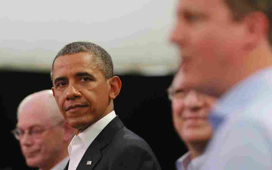 President Obama glances at Britain's Prime Minister David Cameron (right) during a news conference with European Union officials at the G-8 summit in Enniskillen, Northern Ireland, on Monday.