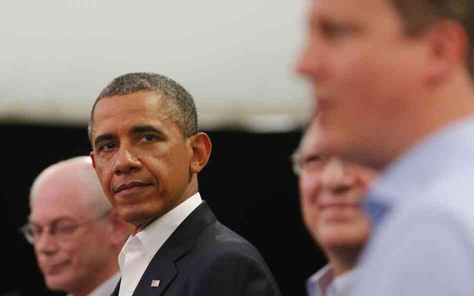 President Obama glances at Britain's Prime Minister David C