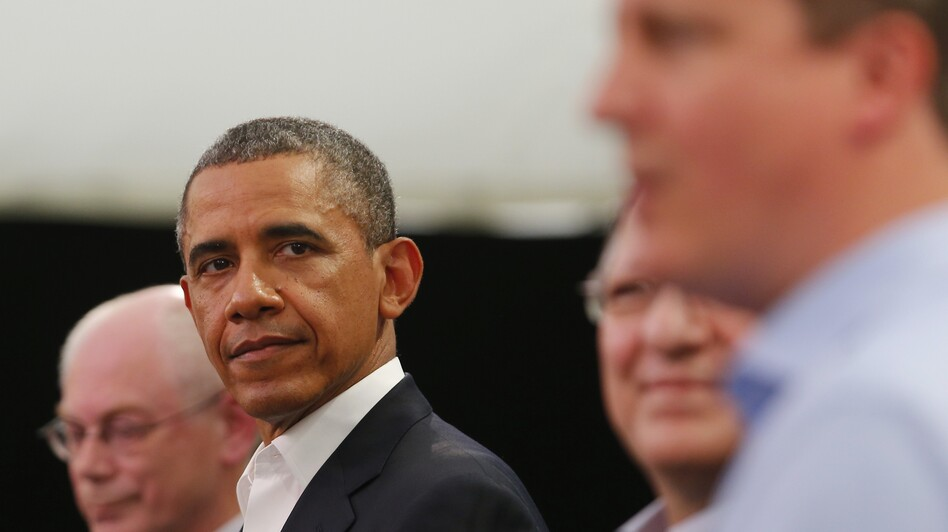 President Obama glances at Britain's Prime Minister David Cameron (right) during a news conference with European Union officials at the G-8 summit in Enniskillen, Northern Ireland, on Monday. (Getty Images)
