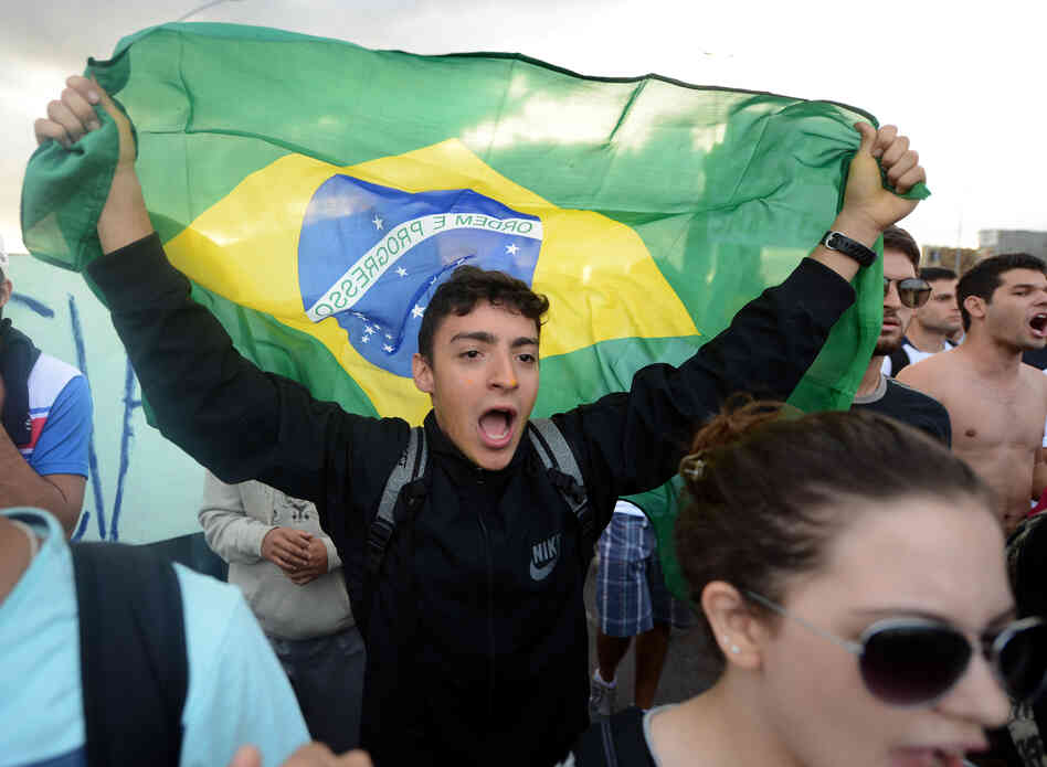 Students shout slogans during a protest Monday in Brasilia.