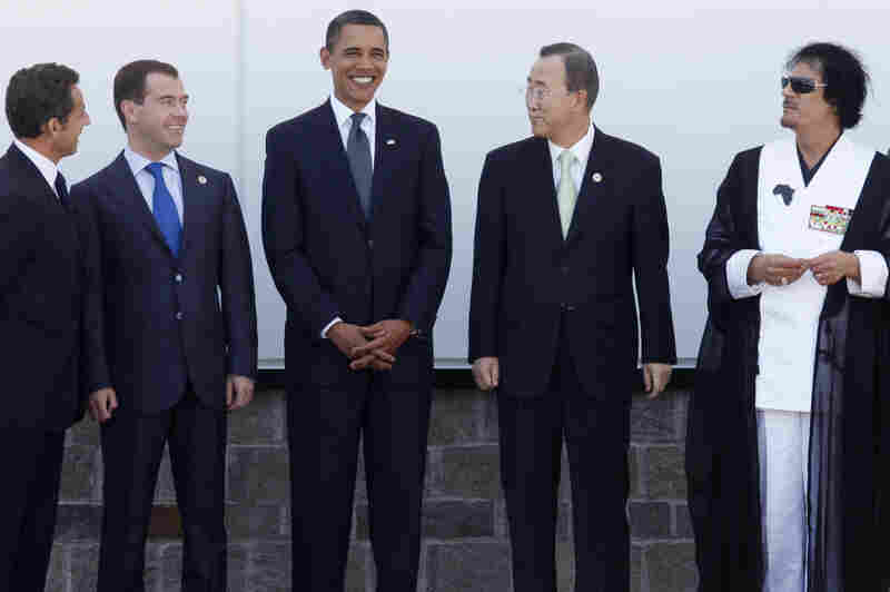 In 2009, Obama stands with Sarkozy (from left), Russian President Dmitry Medvedev, U.N. Secretary-General Ban Ki-moon and Libyan leader Moammar Gadhafi at the G-8 summit in L'Aquila, Italy. Earlier summits had a more formal sartorial tone ...