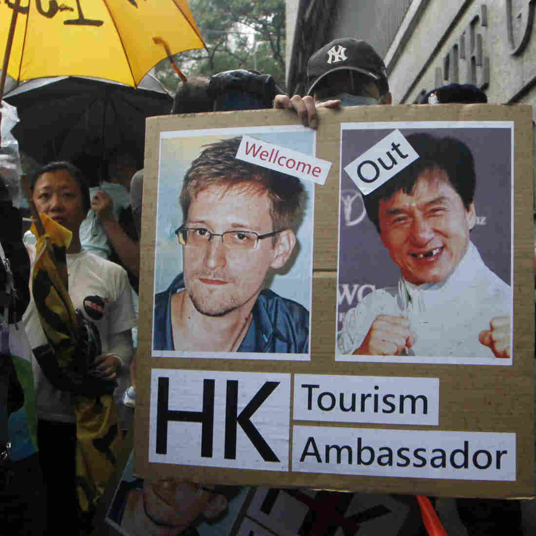 A supporter holds a sign with pictures of Edward Snowden, the former National Security Agency contractor who leaked details about the agency's surveillance programs, and Hong Kong movie star Jackie Chan during a protest outside the Consulate General of the United States in Hong Kong on June 15. Snowden has been holed up in Hong Kong since the leaks.