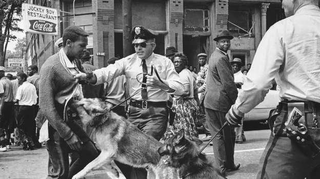 A 17-year-old Civil Rights demonstrator is attacked by a police dog in Birmingham, Ala., on May 3, 1963. This image led the front page of the next day's New York Times. (ASSOCIATED PRESS)