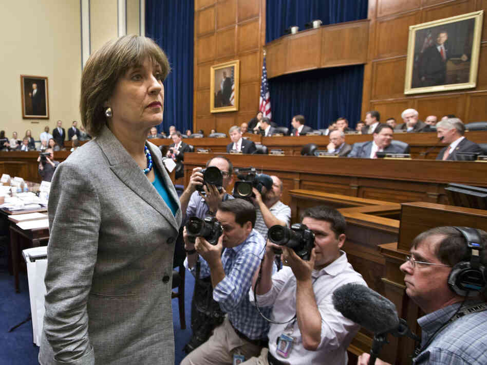 Lois Lerner, head of the IRS unit that decides whether to grant tax-exempt status to groups, leaves a House Oversight and Government Reform Committee hearing in May.