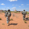 Soldiers advance toward a simulated Afghan town during a training exercise at Fort Bliss in El Paso, Texas, in 2012. While the suicide rate is rising in the military, it's declining for troops stationed at Fort Bliss, thanks in part to efforts to ramp up suicide awareness and prevention training.
