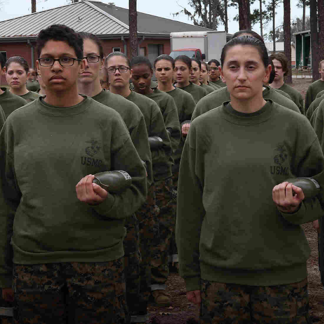Women in the U.S. military will be integrated into front-line combat units by 2016, the Pentagon says. Here, female Marine recruits stand in formation during pugil stick training in boot camp earlier this year at Parris Island, S.C.