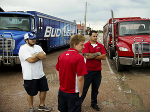 Beer delivery truck drivers wait in Whiteclay on Monday as protesters block their way. Liquor stores in the town sell millions of cans of beer annually to residents of the reservation.