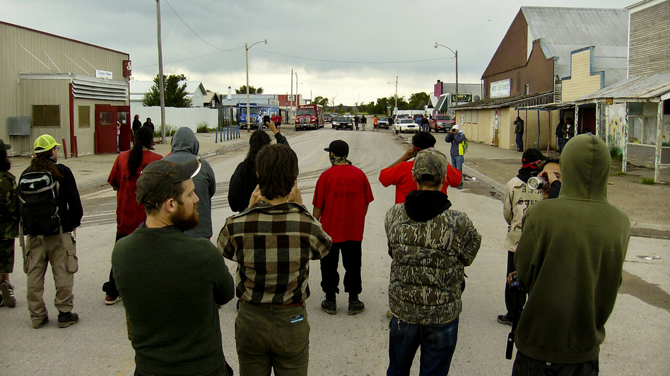Protests against alcohol deliveries are a recurring event in Whiteclay. Authorities have accused the protesters of vandalizing beer trucks, while activists say a liquor store owner has hired people to intimidate them. (Charles Michael Ray/SDPB)