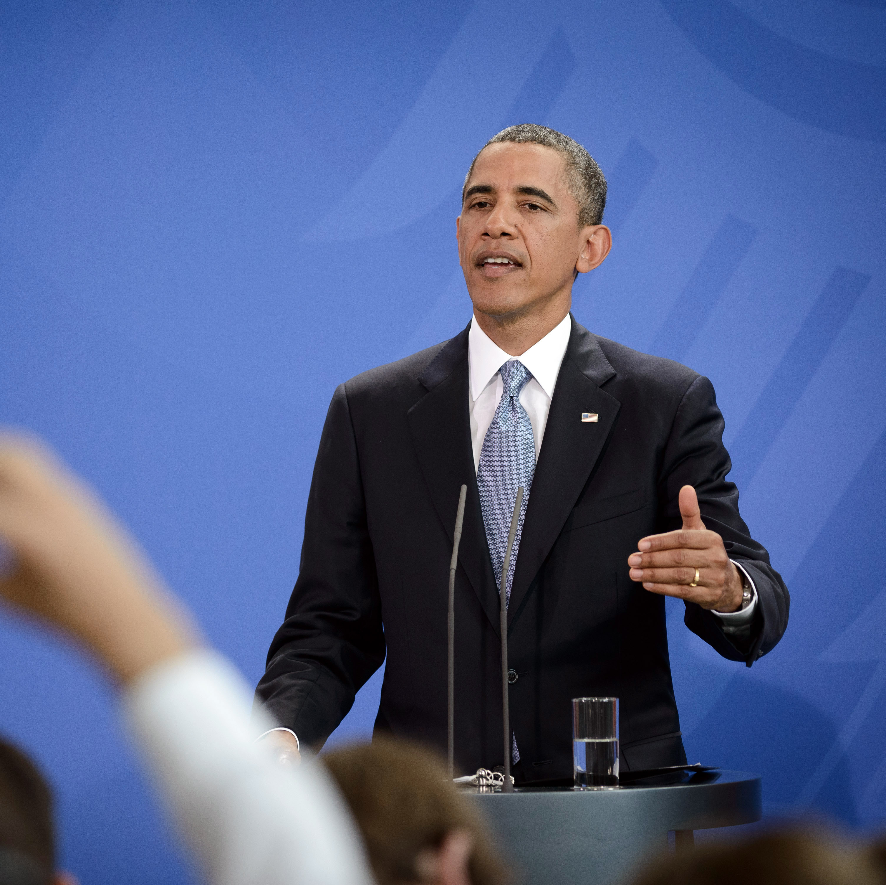 President Obama speaks to the media following bilateral talks with German Chancellor Angela Merkel in Berlin.