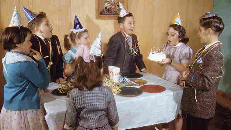 Happy Birthday: Cake, candles and cone-shaped hats make regular appearances at birthday parties. What gives?