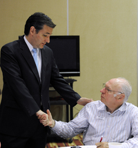 Ted Cruz talks with his father, Rafael, on the day of the GOP primary election in May 2012 at the campaign's phone bank in Houston.