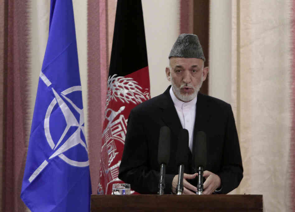 Afghan President Hamid Karzai speaks during a ceremony Tuesday at a military academy on the outskirts of Kabul.