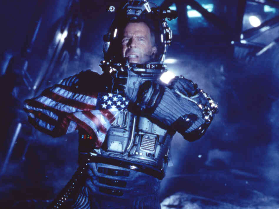Actor Bruce Willis appears on the surface of an asteroid in a scene from the movie Armageddon.