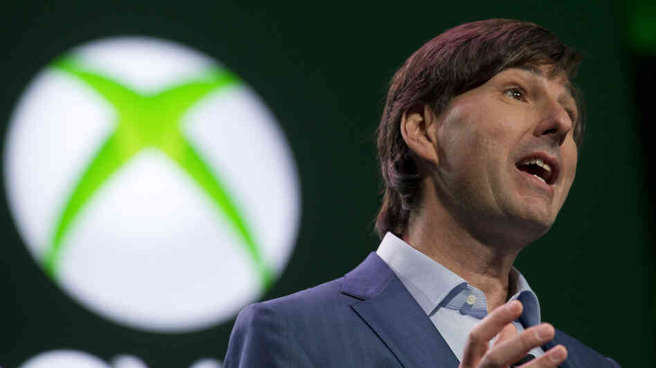 Don Mattrick, president of Interactive Entertainment Business at Microsoft, greets the crowd at the Xbox One reveal event in Redmond, Wash., l